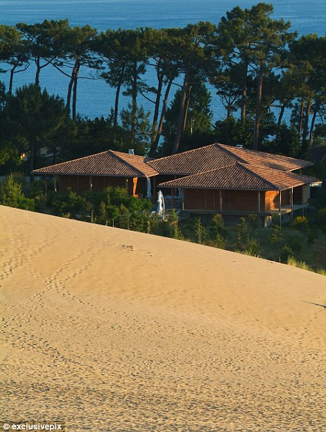 The dune has engulfed surrounding houses and roads over the years