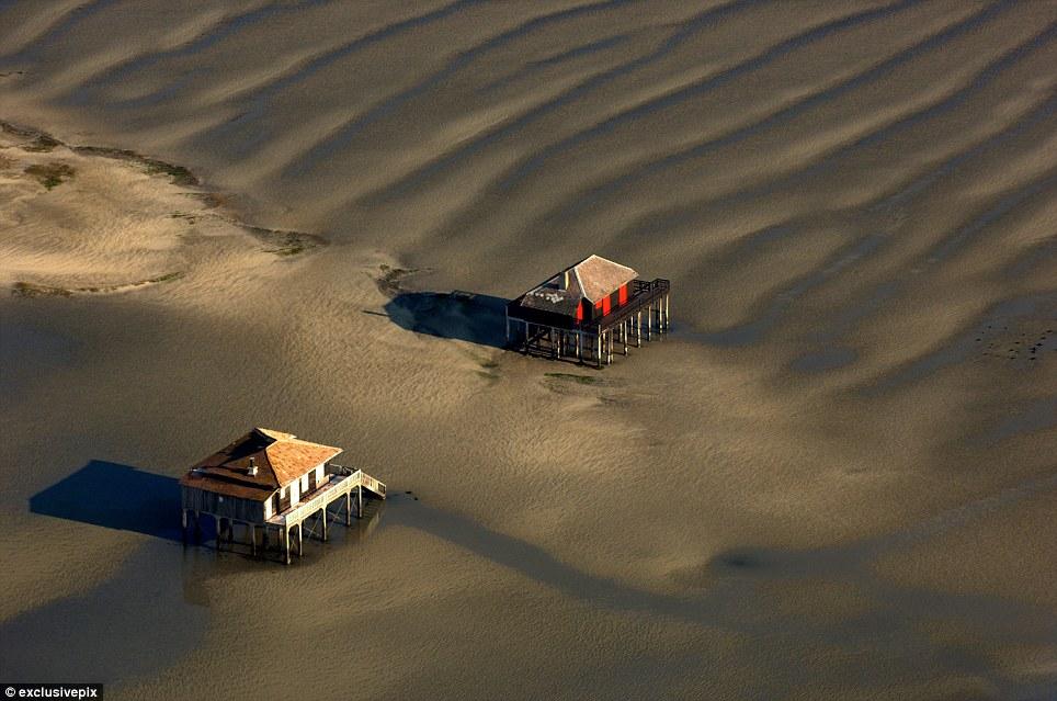 Stilts houses near the dune