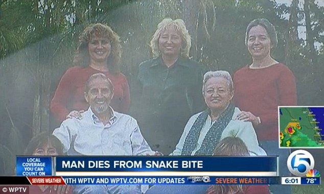 Tough choice: Flora's daughters, pictured at the back behind him, decided he would rather die from a snake bite than continue suffering Alzheimer's