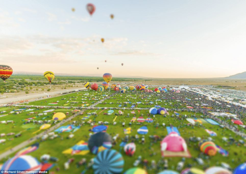 This field of hot air balloons would typically fill the sky with brightly-coloured globes