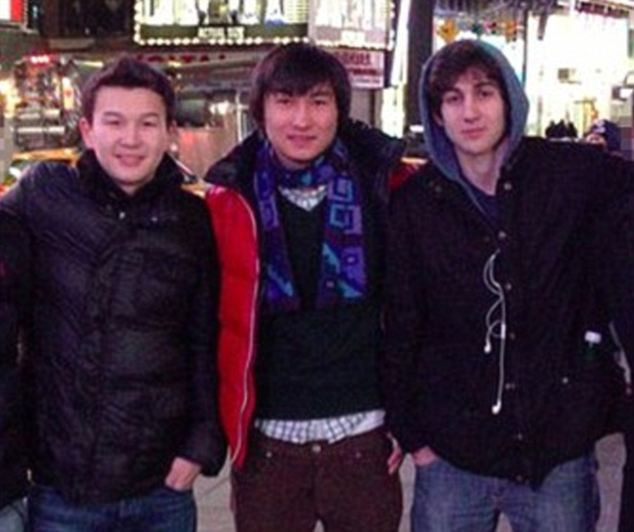 Friends in low places: Dias Kadyrbayev and Azamat Tazhayakov (left and center) were identified as the two friends of Dzhokhar Tsarnaev (right) who have been held in Boston jail since April 20
