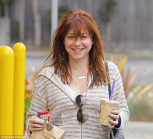 Time for a pick-me-up: Alyson Hannigan spent some rare time alone on Tuesday to grab a snack and run errands