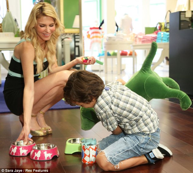 Make believe: The Real Housewives Of Beverly Hills star also helped Jake pretend to feed his giant toy dog