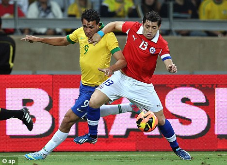 Fight: Leandro Damiao (left) is likely to be playing in Europe