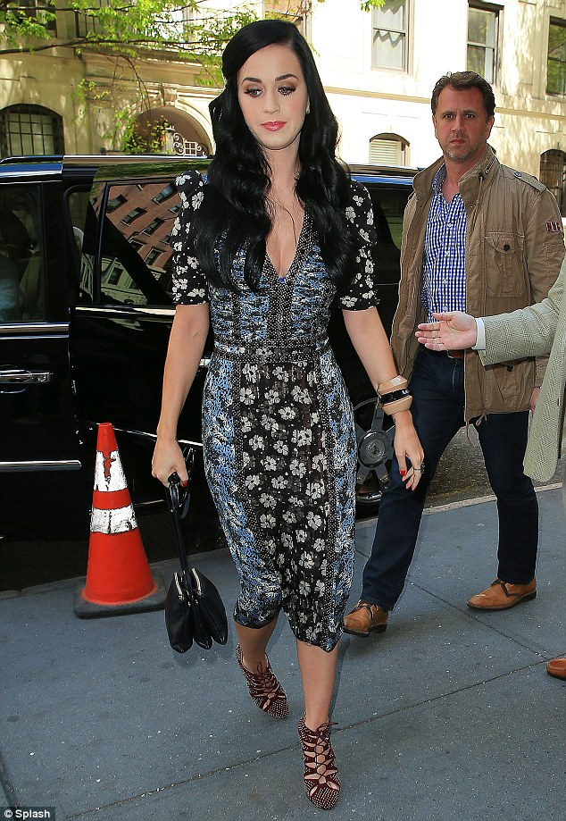 Working hard: Katy's trip to New York is no doubt a welcome break from her grueling recording schedule which has seen the star locked away in the studio for hours on end as she completes her third album