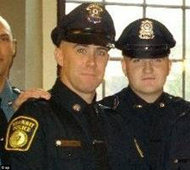 In this 2010 photo provided by the Massachusetts Bay Transportation Authority, Richard Donohue Jr., left, and Sean Collier pose together for a photo at their graduation from the Municipal Police Officers' Academy