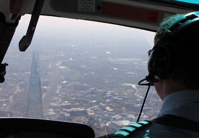 Helicopter pilot flies around the Shard