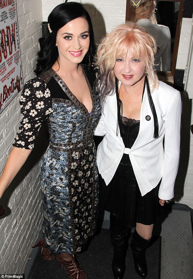 Divas unite: Katy posed with the musical's writer Cyndi Lauper who sported some kinky boots of her own