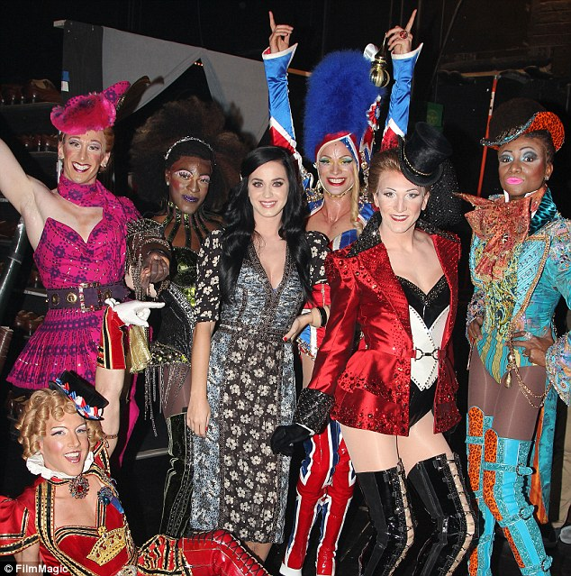 These boots are made for walking: The singer posed with the menagerie of extravagantly dressed cast from the show