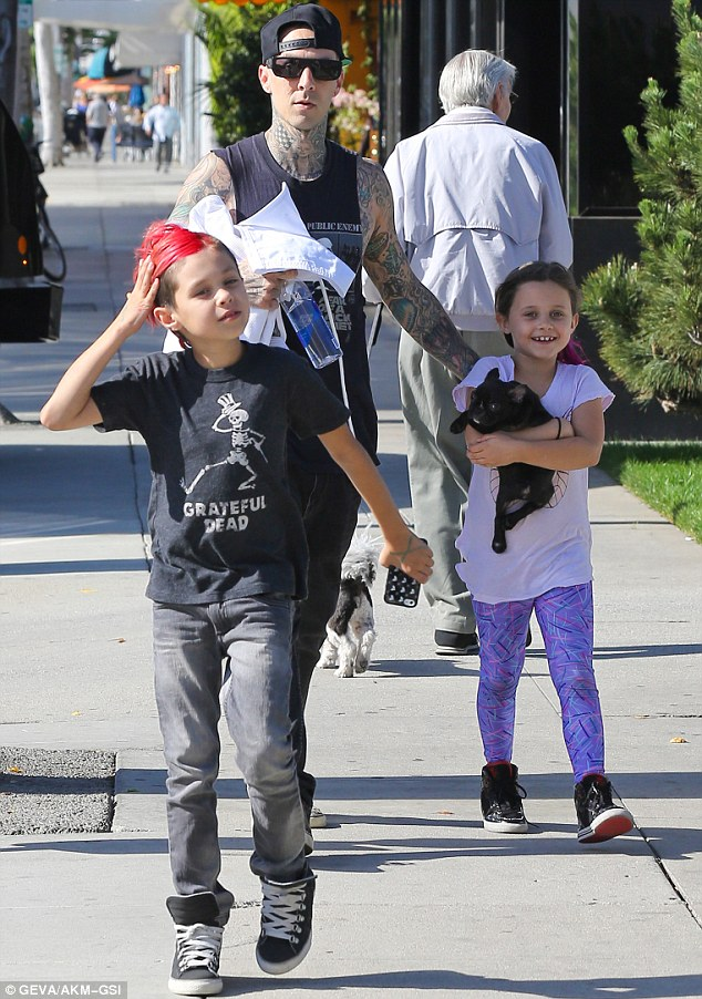 Typical father: Travis seemed protective of his two children during their outing in Beverly Hills