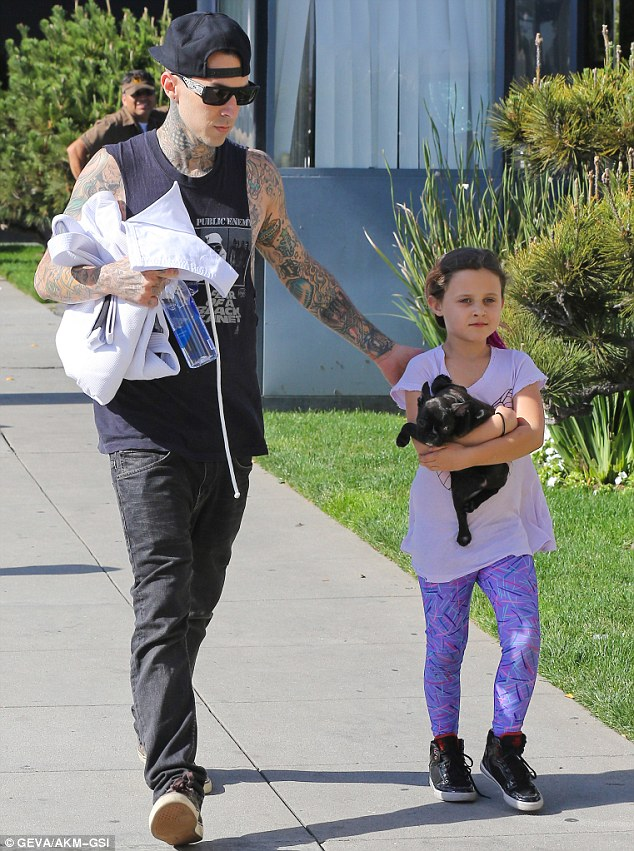 Like father, like daughter: Travis carefully guided his little girl to the Beverly Hills fitness studio