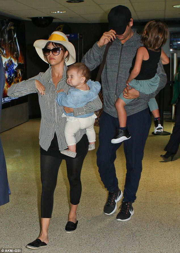Home time: Kourtney arrived back at the same time as Kris with her little ones Mason and Penelope and baby daddy Scott Disick