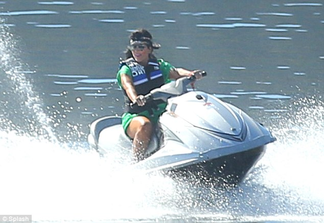 Wild: Kris looked like she was letting her hair down as she enjoyed flying about in the water