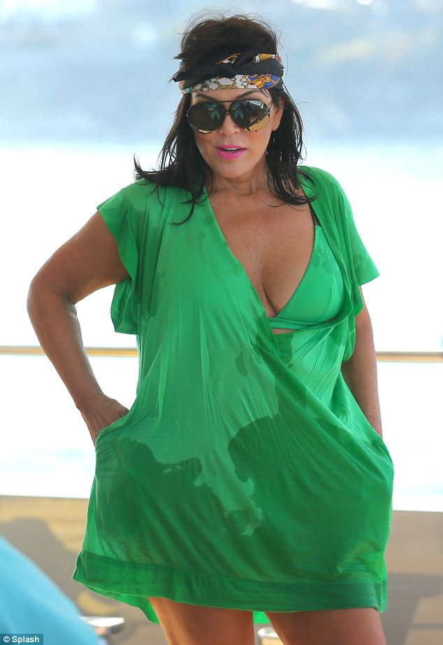 Wigging out: Kris Jenner opted to wear a wig when she went jet skiing on Wednesday during her holiday in Greece