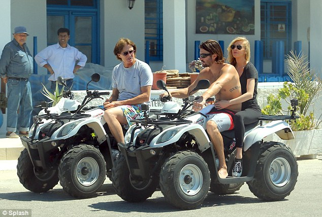 Active: While Kris rode a jet skit Bruce Jenner showed off his ATV riding skills with his son Brandon and his wife Leah