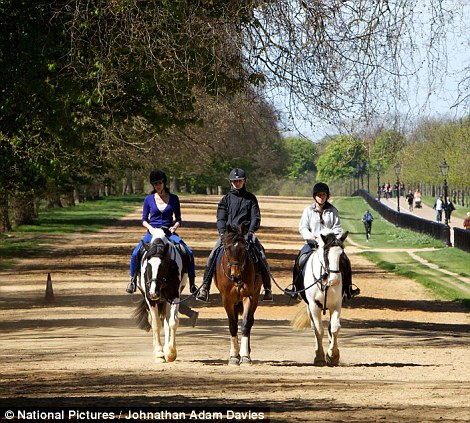 Horse riders enjoy the sunshine in Hyde Park