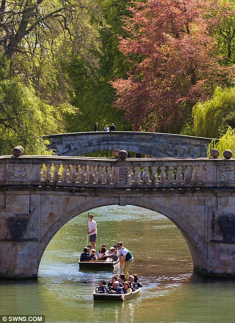 People enjoy the glorious spring sunshine today on the River Cam in Cambridge.