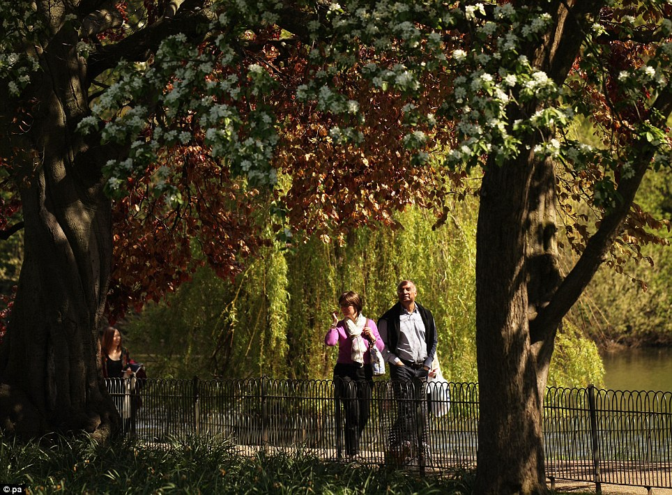 Peaceful: People enjoying the warm weather in St James's Park, central London, as Britain looks forward to a hot weekend