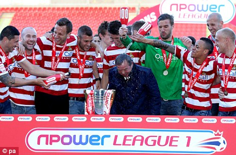 Drama: With seconds to spare Doncaster were going to be resigned to the play-offs, but Coppinger's goal propelled them to the top of the League