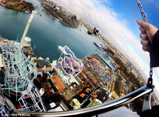 Riding high: Eclipse, the world's tallest chair swing carousel is nearly 400ft high and will take you on a 44mph ride - if you dare!