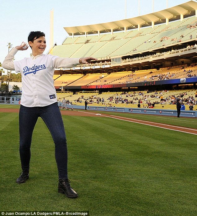 Giving a toss: Ginnifer Goodwin was giggling as she prepared to throw the ceremonial first pitch