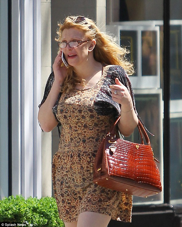 Fuss free: Make-up free Courtney Love looked disheveled in a dowdy hippie dress as she strolled through New York's West Village Thursday afternoon