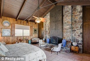 Decor: Many of the rooms have wood paneling with exposed stone, giving the home a ranch-house feel