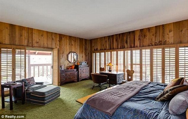 While kitchen and bathroom appliances have been updated, the house has maintained its 1960s feel with green and red wall-to-wall carpeting in some rooms and 1960s-era wallpapering