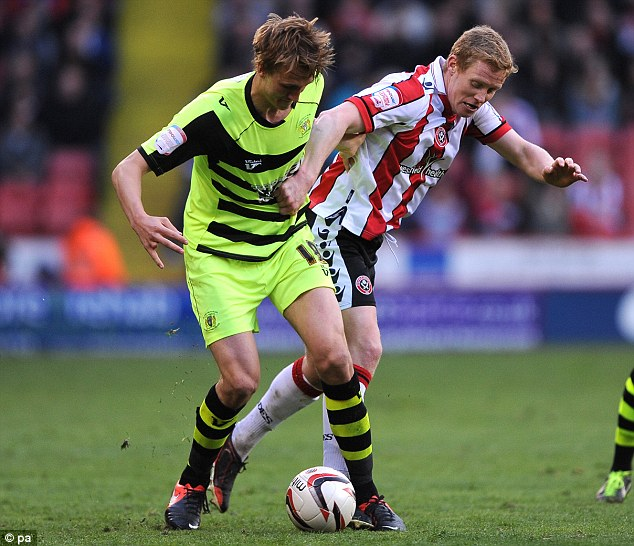 Early setback: Barry Robson (right) was forced off injured for Sheffield United after 30 minutes