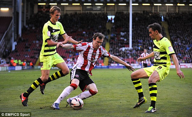 Pressure: Sheffield United's Kevin McDonald evades tackles from Yeovil's Ed Upson (right) and Dan Burn (left).