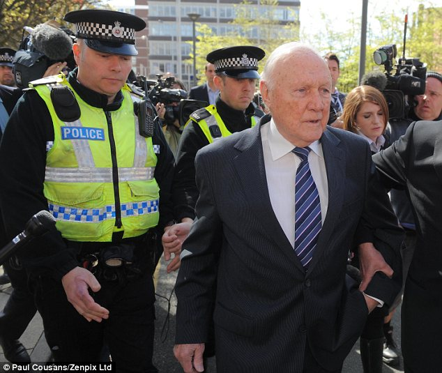 Led away: Hall outside Preston Crown Court yesterday after pleading guilty to molesting 13 girls
