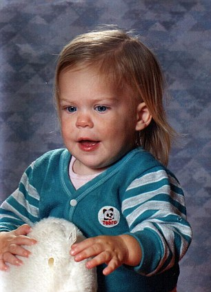 Childhood: Kelly in 1988 aged eight months old