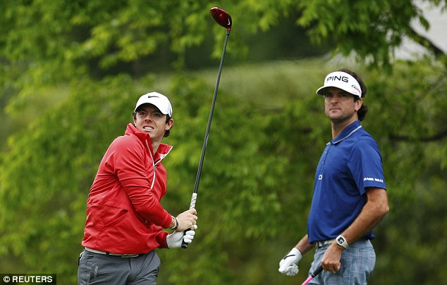 Share of the lead: Bubba Watson (right) watched McIlroy tee off
