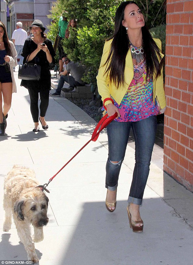 Merrily we stroll along: The reality star seemed happy as she walked in Beverly Hills with her dog