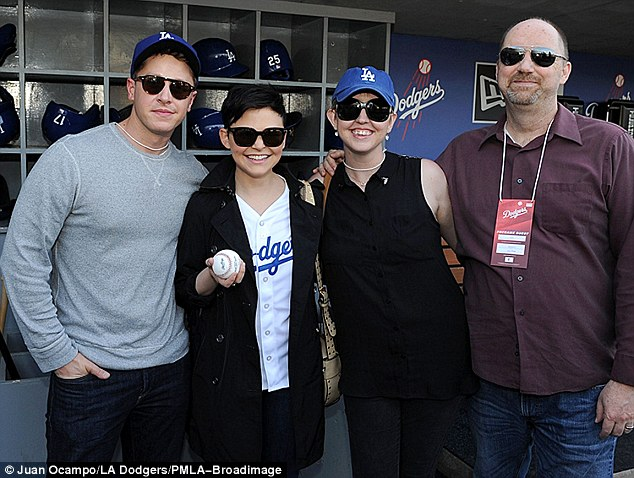 Family affair: Ginnifer was joined by her boyfriend Josh Dallas and her elder sister at the ball game