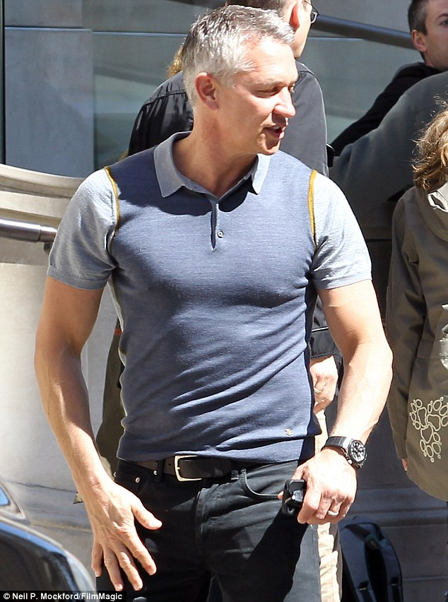 Been hitting the gym? The 52-year-old football pundit was showing off his bulging biceps and bulkier chest in a tight-fitting polo shirt