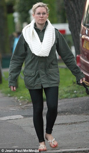Casual: The star wore a khaki jacket with a cream snood, leggings and flip flops
