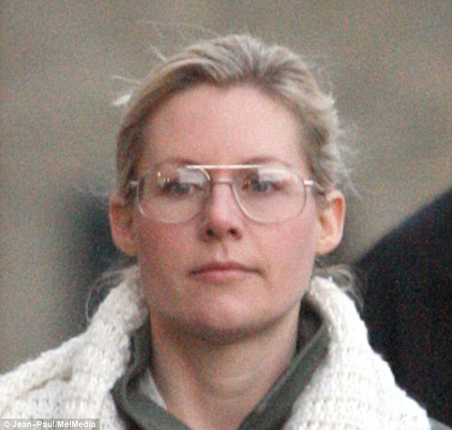 Geek chic: Abi wore a pair of large glasses and no make-up, while her hair was off her face
