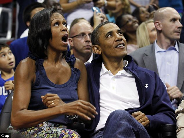 Obama and wife Michelle watch a game: Media strategists say there is clear data to show that influential political figures are increasingly watching sports