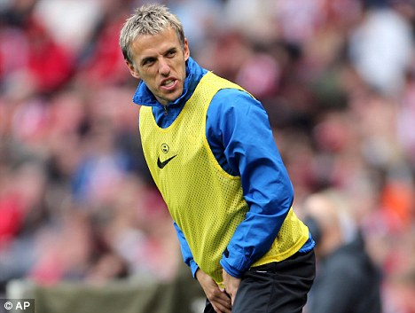 Feeling the strain: Phil Neville will miss the Merseyside derby
