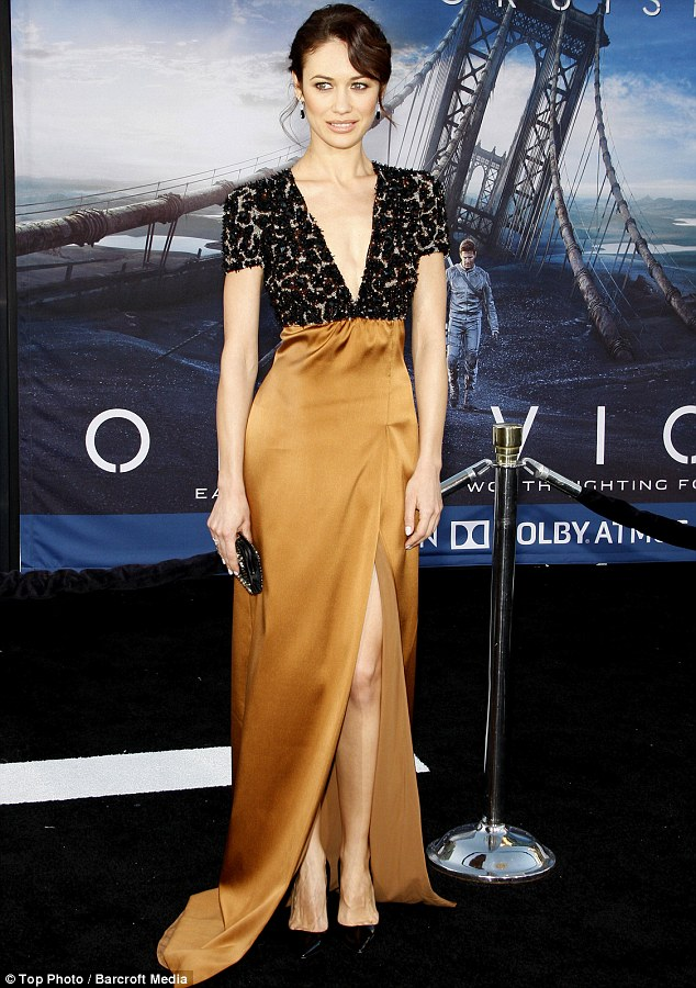 Statuesque: Olga shone in a lace and silk gown for the April premiere of Oblivion
