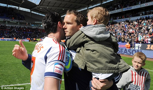 End of an era: Davies being congratulated by Chris Eagles