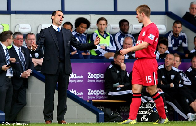 Escape artists: Martinez and Wigan secured a 3-2 win over West Brom and could stay up yet again