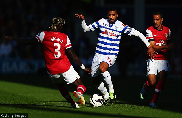 Fifty-fifty: Arsenal's Bacary Sagna and QPR's Armand Traore contest the ball