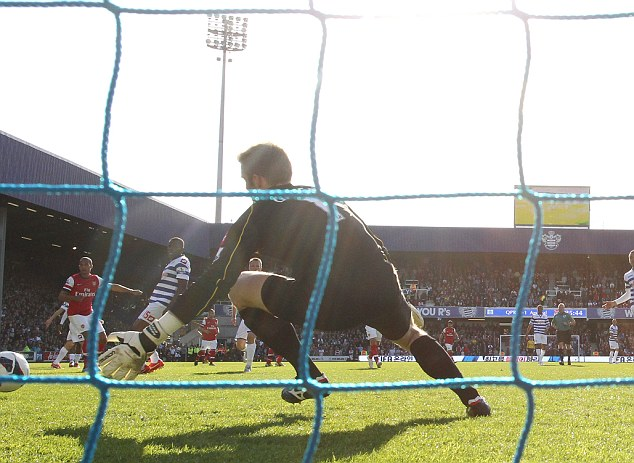 Palmed: Rob Green pushes Theo Walcott's shot in the first half on to the post