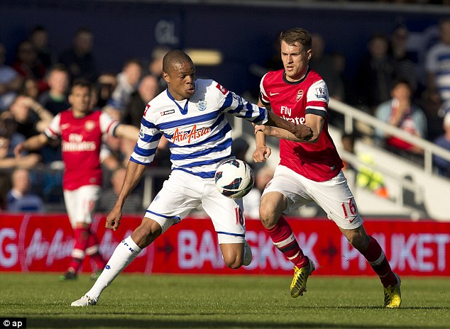 Control: Loic Remy holds off Arsenal's Aaron Ramsey