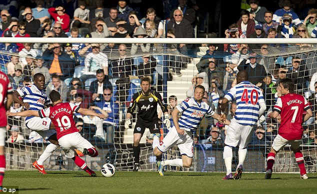 Shooting opportunity: Santi Cazorla gets a shot off as QPR players scramble to block it