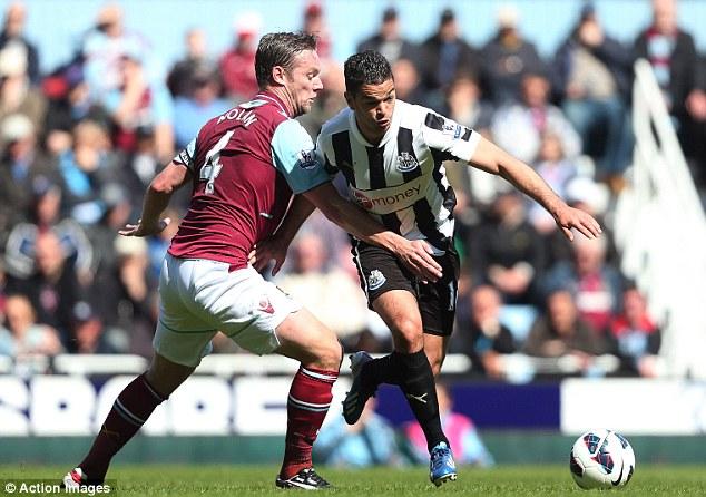 Tricky: Newcastle forward Hatem Ben Arfa (right) nips past Kevin Nolan at Upton Park