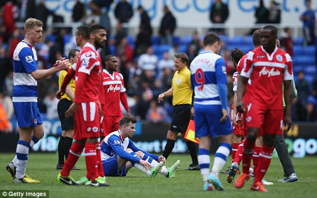 Dejection: QPR's relegation was confirmed in a dismal 0-0 draw at Reading last weekend