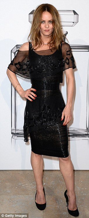 The ex factor: Meanwhile, Johnny's estranged wife Vanessa Paradis posed at a photo call for the No. 5 Culture Chanel exhibition at Palais De Tokyo in Paris, France on Friday night